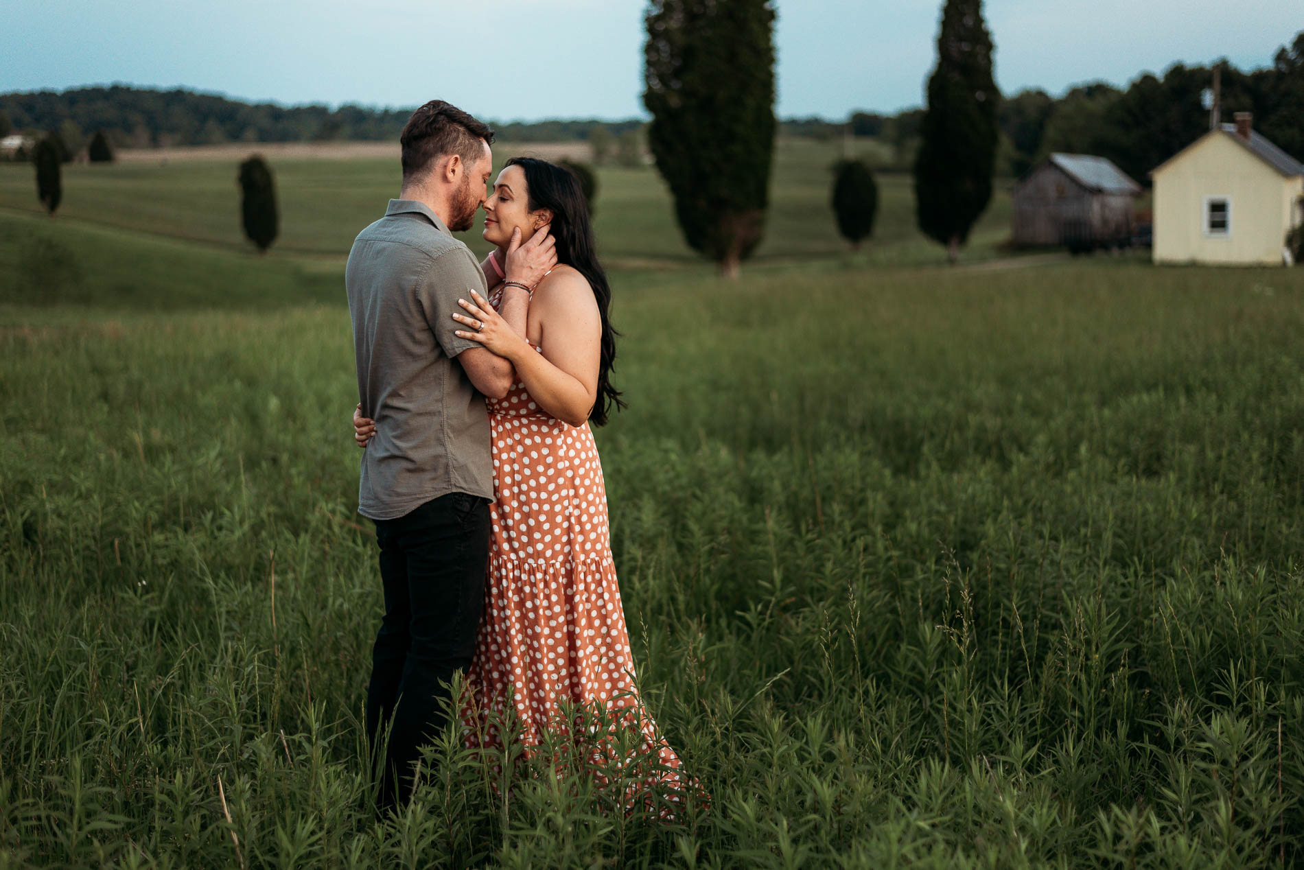 Engagement photo of couple in field