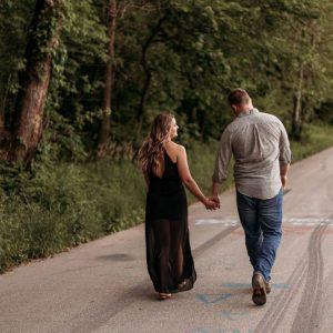 Engaged couple walking on road