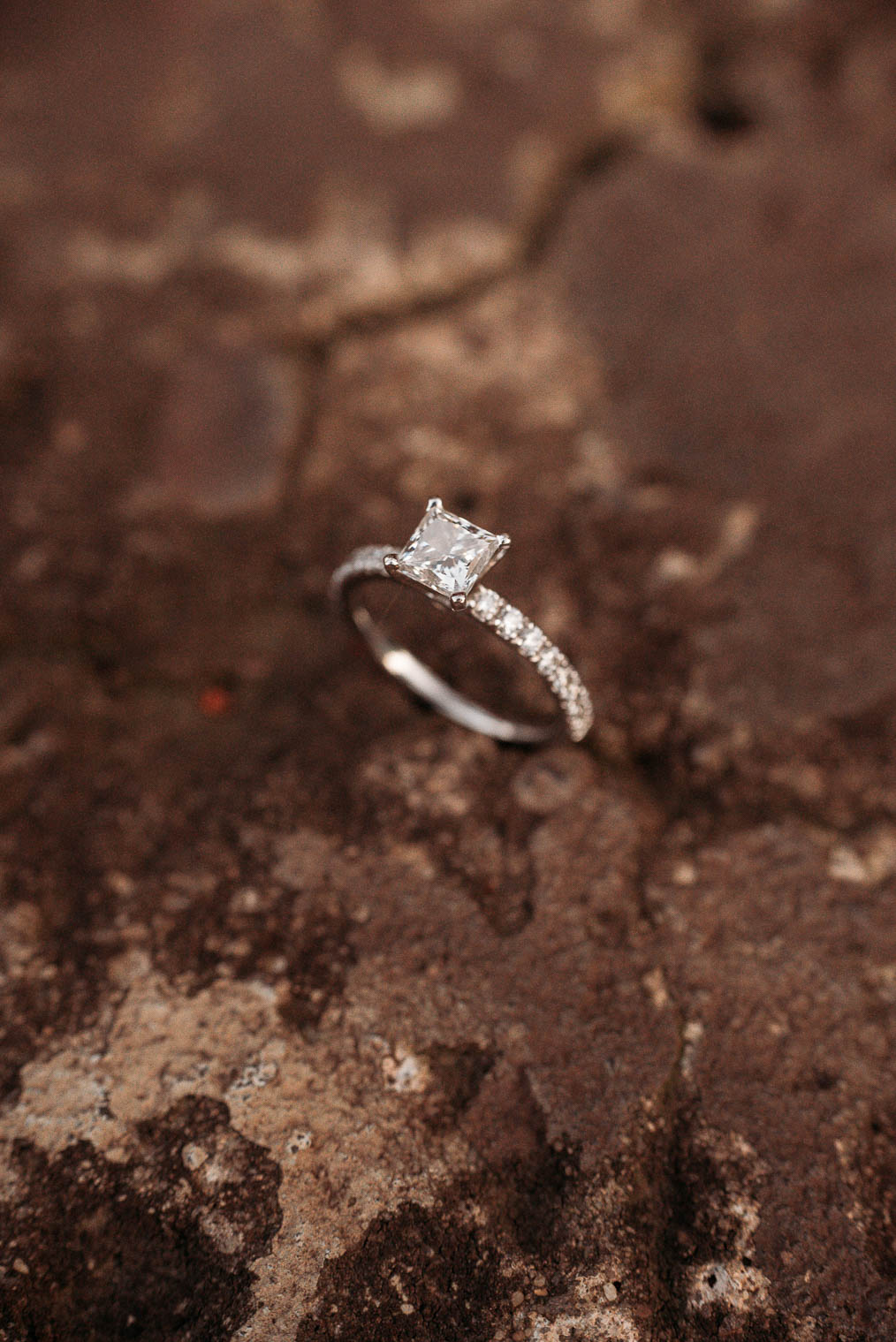 engagement ring on rustic surface