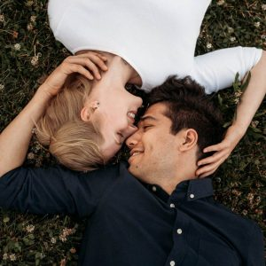 Couple laying on the ground Affectionately
