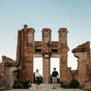 Engaged couple in front of ruins