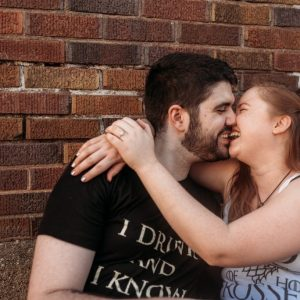 quirky couple laughing and kissing
