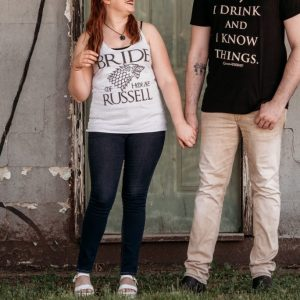 Couple holding hands with GOT graphic tees